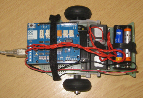 Top View with Arduino Motor Shield on top of Freedom board and motor chassis