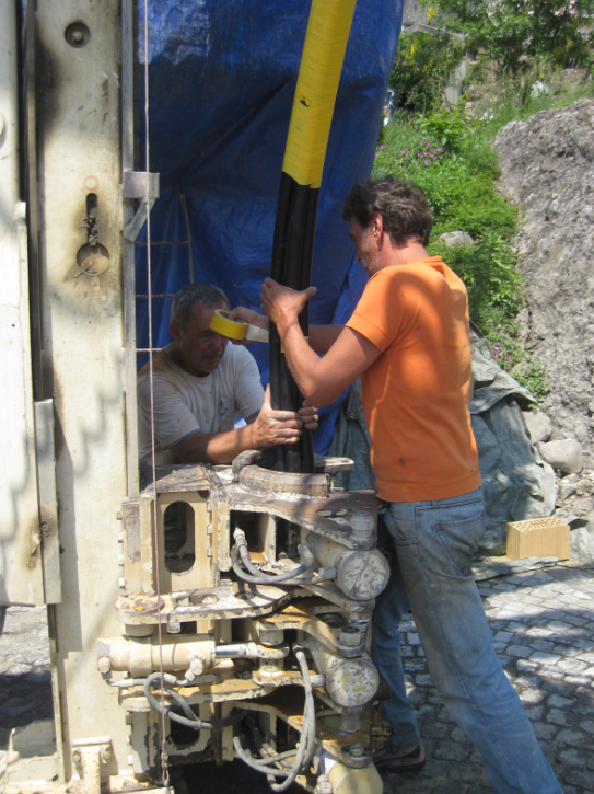 Pushing the pipes into the drilling hole