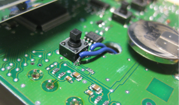 Wires soldered to push button